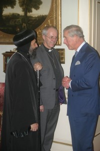 The Prince of Wales talks about the plight of Christians in the Middle East with Bishop Angaelos, General Bishop of the Coptic Orthodox Church in the UK; and the Archbishop of Canterbury, the Most Revd Justin Welby; during a reception at Clarence House, in December last year.